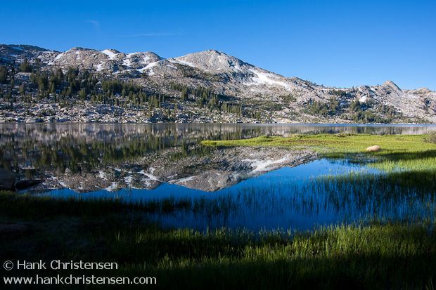 Mountains south of Emigrant Lake are reflected in the early morning light, Emigrant Wilderness, California