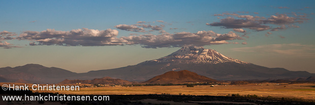 Mount Shasta glows in the warm light of sunset, Weed, California