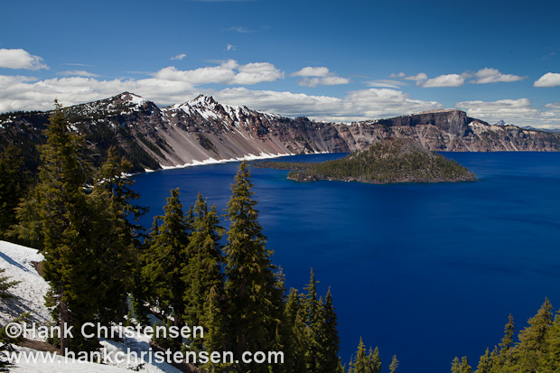 Mount Mazama exploded nearly 8,000 years ago, creating an eruption 100 times larger than Mount St. Helens in 1980.  The mountain's summit collapsed, forming a caldera 6 miles in diameter.  Over time, rain water and snow melt filled the chasm, creating one of the 10 deepest lakes in the world.