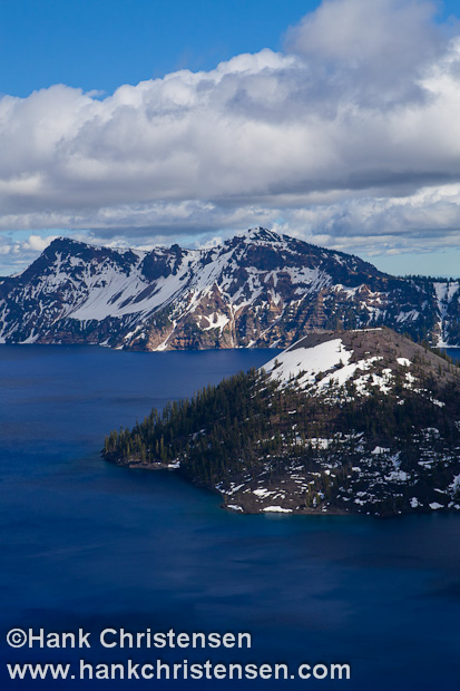 The cinder cone of Wizard Island sits just off the rim of Crater Lake