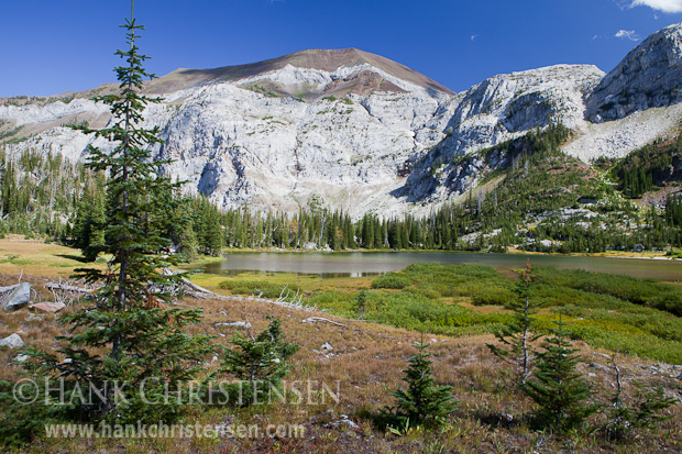 White limestone cliffs tower above Frazier Lake, Eagle Cap Wilderness, Oregon