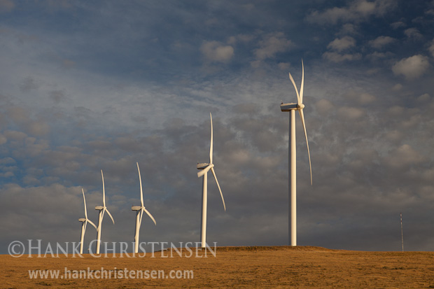 The white spires of a wind farm stand out against a darkening sky, Columbia River Gorge, Oregon