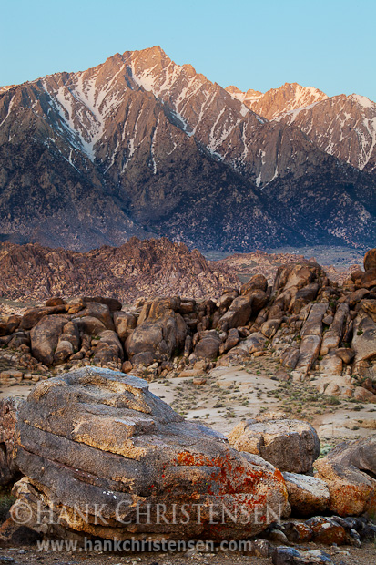 Various patterns and colors of rock form layers to the face of Mt. Langley, Alabama Hills, CA