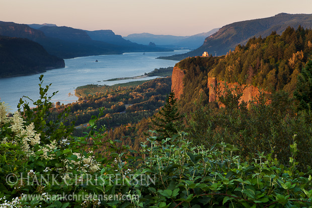 The sun sets on the Crown Point Vista House, overlooking the Columbia River Gorge, Oregon
