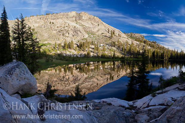 A calm lakes reflects the surrounding cliffs in early morning, Ten Lakes, Yosemite National Park