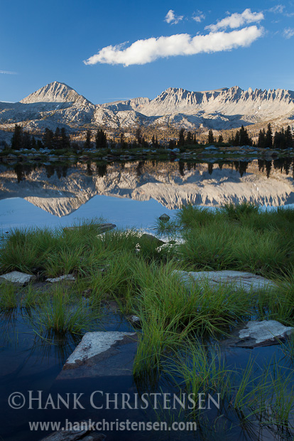 Mountains are reflected in the smooth surface of Davis Lake at sunset, Ansel Adams Wilderness