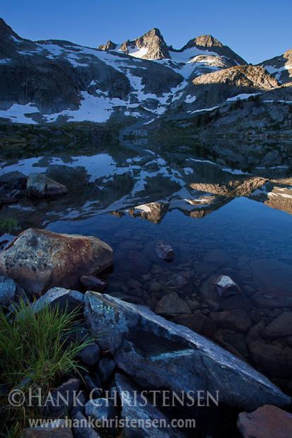 Mt. Davis is reflected in the still morning waters of Davis Lake, Ansel Adams Wilderness