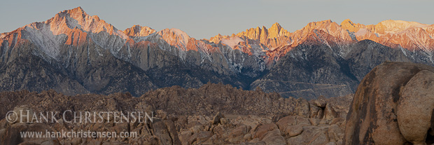 The wall of the eastern Sierra rises over ten thousand feet above the Alabama Hills at dawn