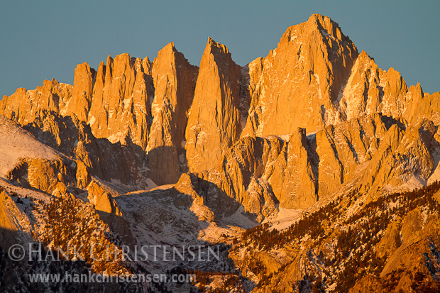 Moments after the sun rises over the Nevada desert, the peak of Mt. Whitney glows a bright orange