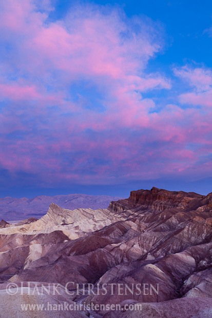 Clouds explode with light over the multi-colored rock at Zabriskie Point, Death Valley National Park