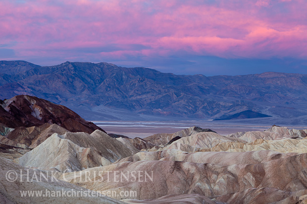 Dawn light permeates the clouds at Zabriskie Point, Death Valley National Park