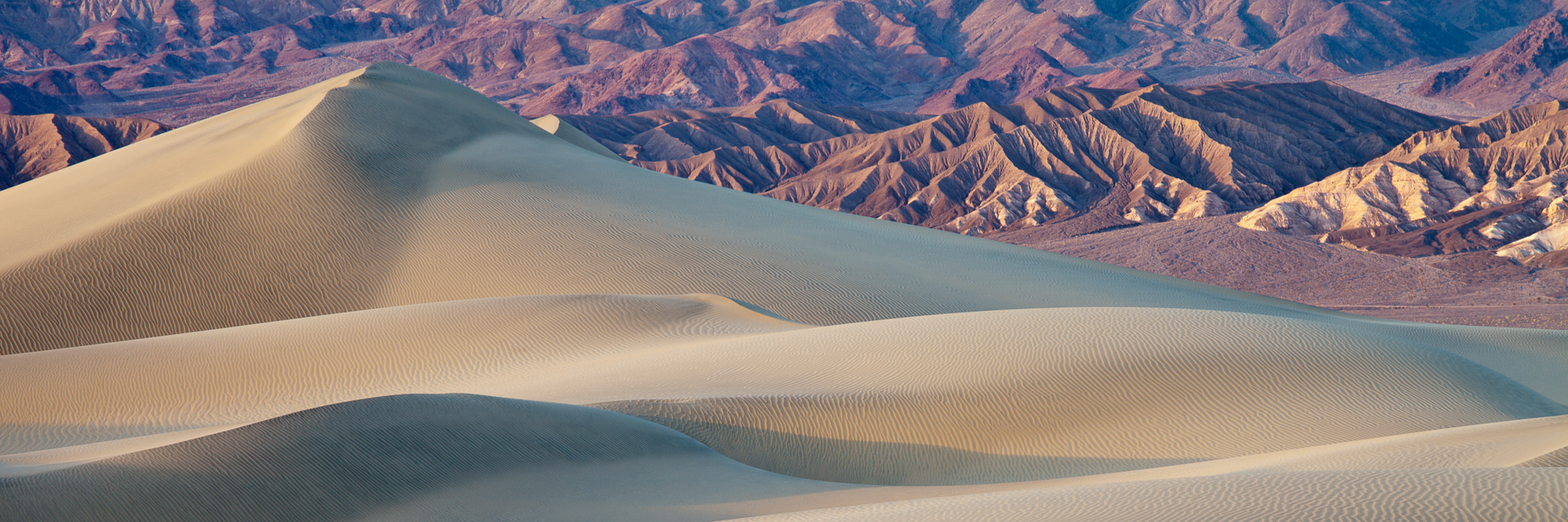 Mountains rise beyond the sand dunes of Mesquite Flat, Death Valley National Park