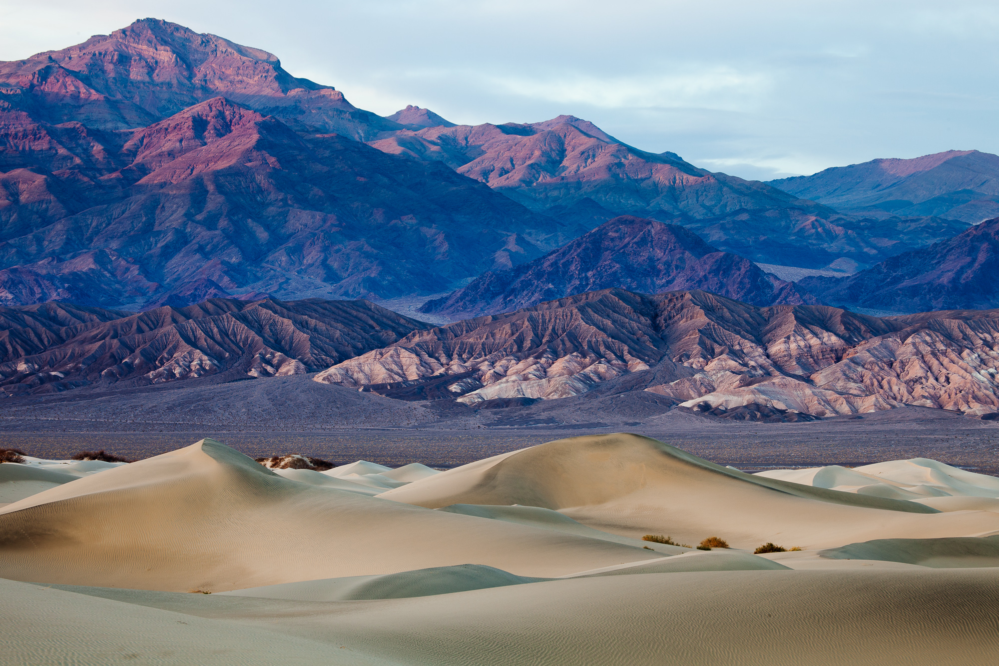 Visitors to Stovepipe Wells are treated to a view of wind carved sand dunes across Mesquite Flat, Death Valley National Park