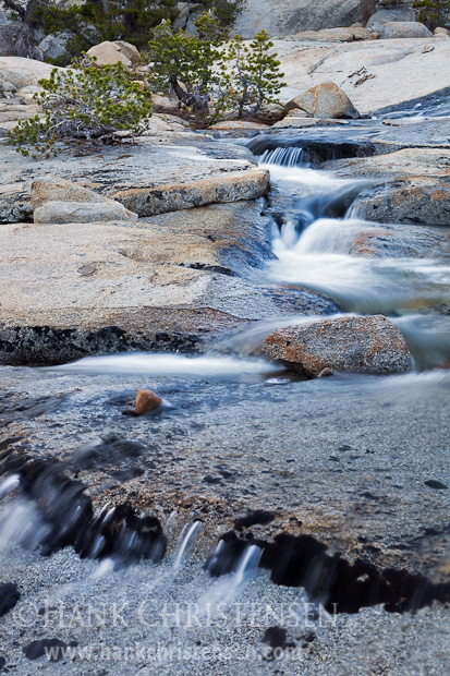 Water cascades down flat, open granite above Wilma Lake, Yosemite National Park