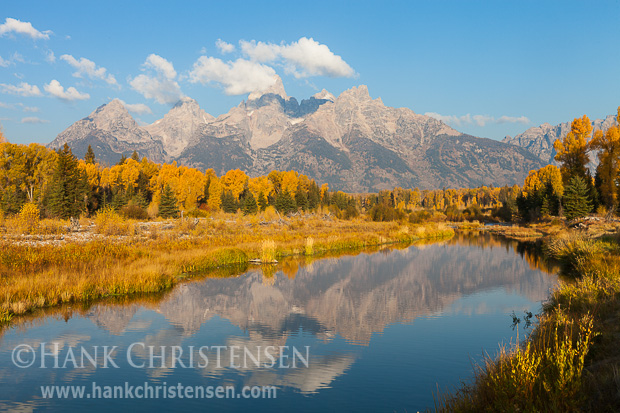 The Tetons are reflected in the Snake River at Schwabacher's Landing, Grand Teton National Park