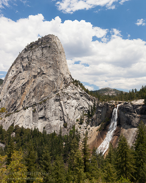 Liberty Cap looms above Nevada Falls, showing mid summer flow
