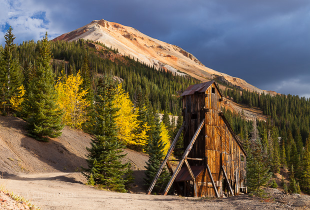 Silver ore was carted out by 75 mules every day. Here the old mine is front lit with dramatic dark skies beyond.