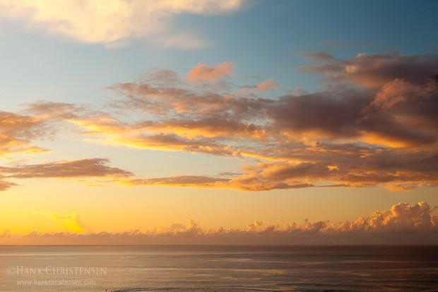 Clouds billow over the water at sunset, Kauai, Hawaii