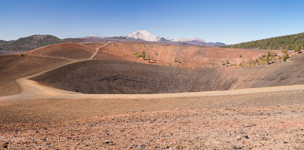 A large cinder cone sits to the east of Mt. Lassen in Northern California.  A trail decends a hundred feet into the mouth of the cinder cone to a large steam vent.