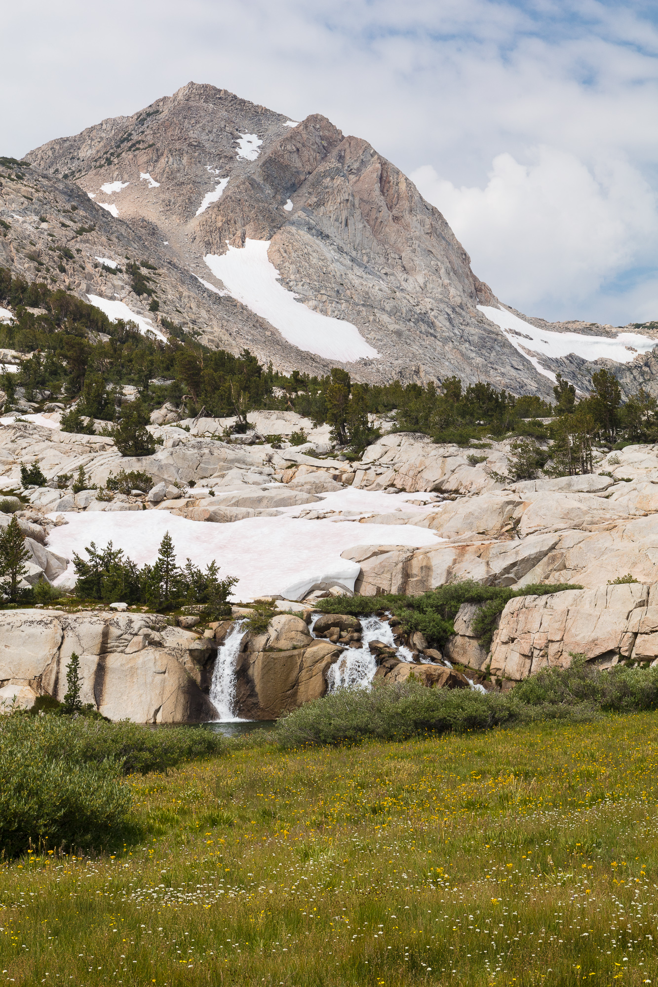 Snowmelt feeds waterfalls on the climb up to Piute Pass, Inyo National Forest, CA.